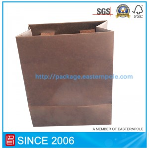 Luxury shopping bag with glued handle